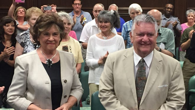 Miriam and Joe Perri receive a standing ovation from the crowd at Richland County Juvenile Court during the Love Never Fails awards ceremony.