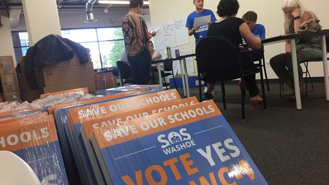 Organizers and volunteers for the Save Our Schools campaign call voters on July 6, kicking off voter-outreach for the effort to pass a sales-tax increase for public schools in the 2016 election. They're at campaign headquarters in Downtown Reno.