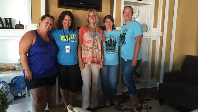Five members of the staff at Exceptional Care for Children stand in the Newark-area facility's living room. From left are Amanda Grasmuck, Christina Loillis, Danielle Dennison, Holly Feret and Heather Casile.