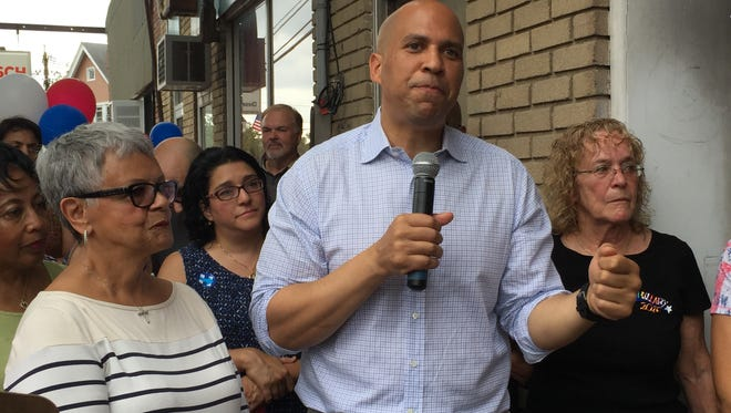 Congresswoman Bonnie Watson Coleman, U.S. Sen. Cory Booker and Somerset County Democratic Chairwoman Peg Schaffer at ribbon cutting of new Somerset County Democratic Headquarters in Somerville on Saturday.