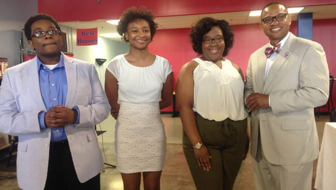 Lane College President, Dr. Logan Hampton, poses for photos with Zachariah Cunningham, left, Keyann Reaves, middle, and Cynthia Henning, on Saturday, Aug. 6.