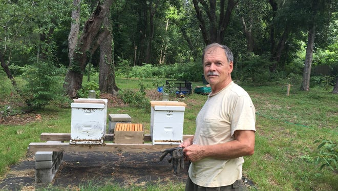Fred Calder is concerned that widespread spraying for mosquitoes could harm not only his bees but the butterflies and native bees that pollinate plants in the surrounding Oak Knoll neighborhood.