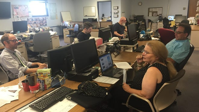 Editor Rob Mitchell, far left, with staff in the Rutland Herald newsroom Monday afternoon. Staff of the newspaper and sister paper the Times Argus, met Monday, August 8, 2016, following news the family-owned media company failed to pay employees and paper carriers the previous week.