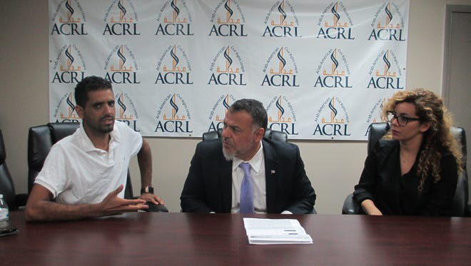 Mohamed Wassel, of Hamtramck, talks about him and his brother, Omar, being arrested by Hamtramck Police. On right are his attorney Nabih Ayad and Rula Aoun, both leaders with the Arab American Civil Rights League.