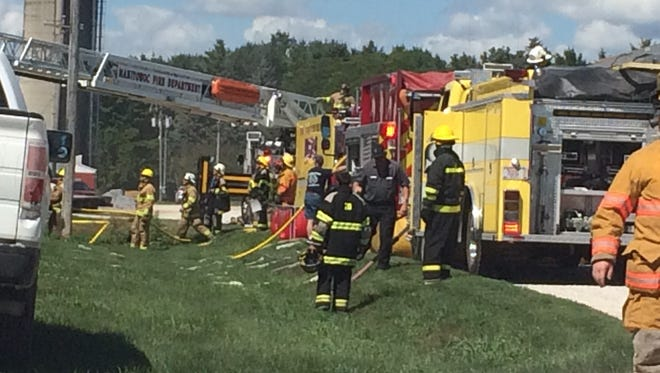 Fire crews work on controlling the blaze at Meadow Brook Dairy in the town of Kossuth in Manitowoc County.