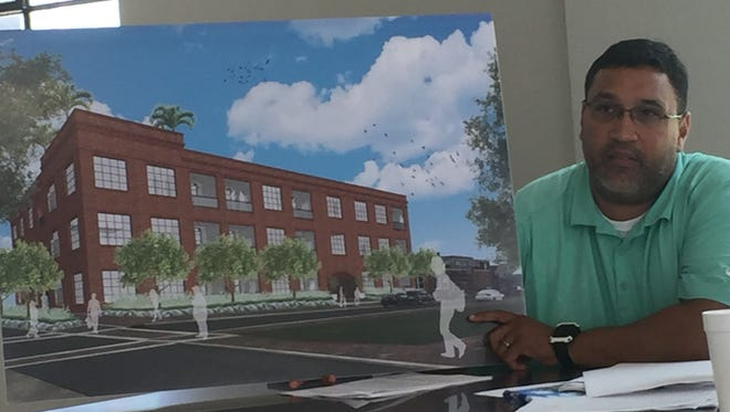 LPTFA board member Pat Magee holds a rendering of proposed lofts at Olivier and Monroe streets near downtown Lafayette, LA. Aug. 9, 2016.
