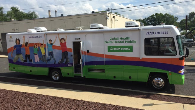 The Zufall Delta Dental Mobile van was unveiled Wednesday at Zufall's Somerville office.