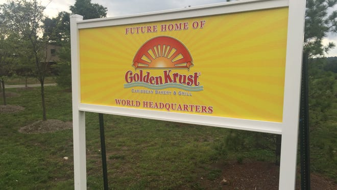 A sign on Route 303 in Orangetown advertises the future home of the world headquarters for Golden Krust Caribbean Bakery and Grill. The Bronx-based bakery plans a $37 million bakery, distribution facility and corporate suite, according to its Rockland Industrial Development Agency application.