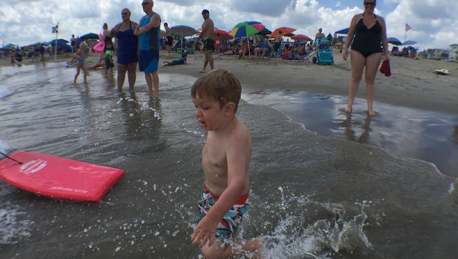 Maddox Mead, 3, spent the day in the water in Ocean Grove on Friday. He and his family were visiting from Rhode Island.