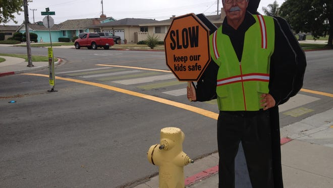 A wooden cutout of beloved crossing guard Jim Mahoney stands sentry at Mission Park School in Salinas on Friday.