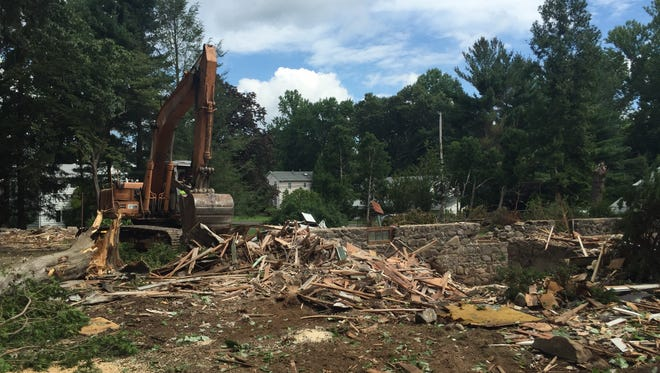 Crews were working at 86 Highview Road in Monsey on the morning of Aug. 11, 2016. A large earth-moving machine was placing scattered debris from the recently demolished house into a dumpster. Only the house's stone foundation remained. Elsewhere on the property, tree removal crews were tossing large, felled trees and branches into a wood chipper.