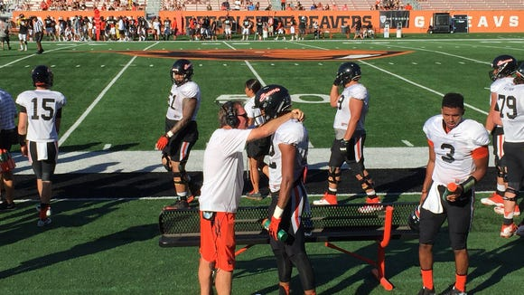 Oregon State's Seth Collins converses with inside receivers
