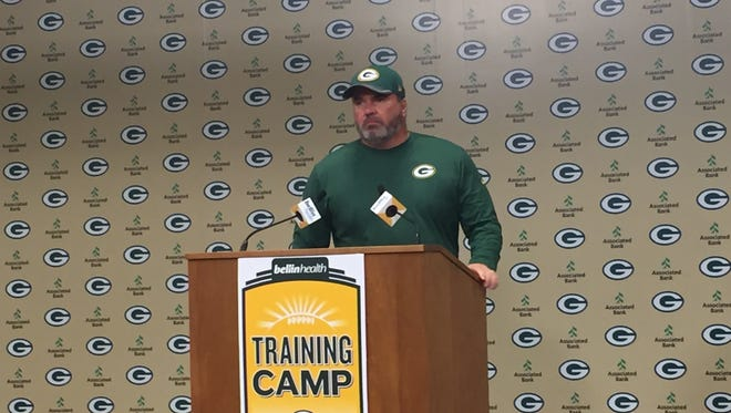 Packers coach Mike McCarthy addresses the media