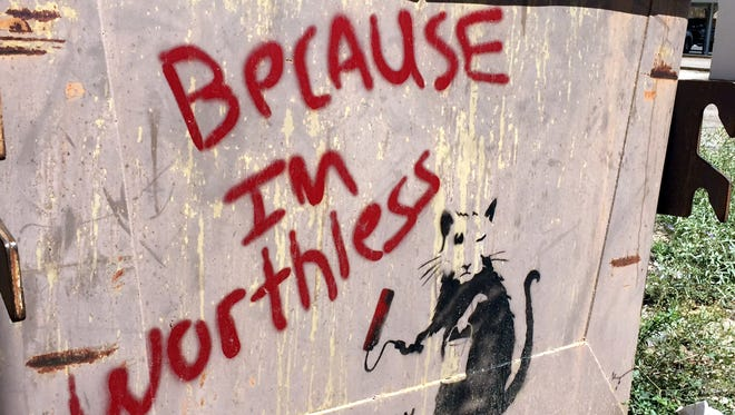 Did Banksy leave his calling card on a city dumpster in a Deming alley?