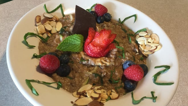The hidden greens protein bowl ($9) is  made with gluten free steel cut oats, quinoa, shredded zucchini, shredded spinach and chocolate protein powder. It is topped with toasted almonds, seasonal berries, creamy peanut butter and a splash of almond milk.