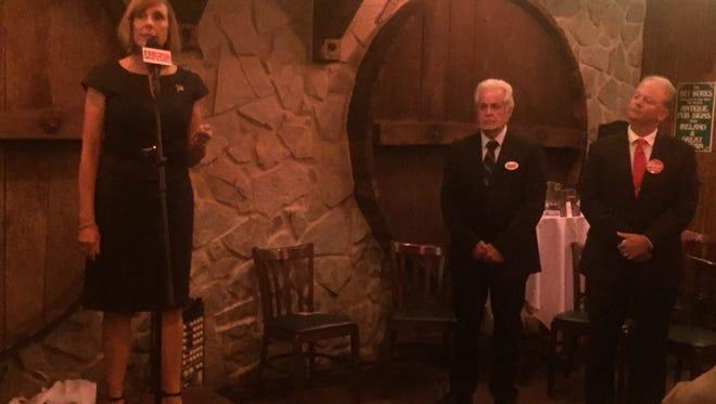 County Commission candidate Karen Sindel addresses the crowd inside the Irish Politicians Club room at McGuire's Irish Pub.