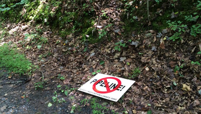 A pipeline opposition sign lies on the ground near land Dominion Energy surveyed for its proposed Atlantic Coast Pipeline on the property of Holley Scheffel in Deerfield, Virginia, on August 18, 2016.