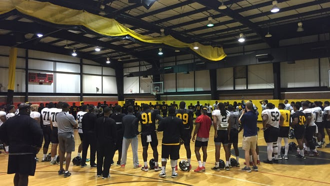 Members of Grambling's football team stand in a circle, or the ring, following Wednesday's practice.