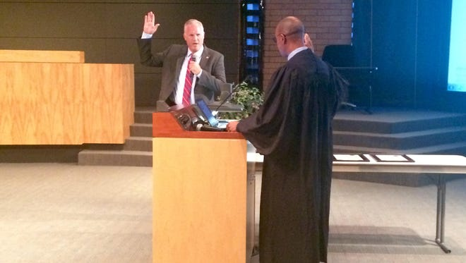 Interim Gilbert Councilman James Candland is sworn in Thursday, Aug. 18.