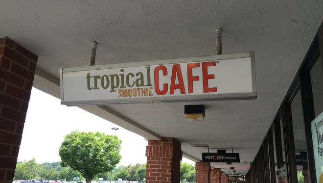 A sign hangs outside the front of the Tropical Smoothie Cafe in Staunton.