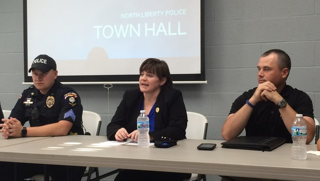 North Liberty Police Chief Diane Venenga (center) speaks at a question-and-answer session with community members Sunday night.