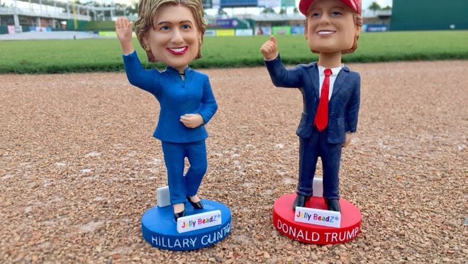 Fans at the Thursday, Aug. 25, 2016, Fort Myers Miracle game can choose between bobbleheads of Hillary Clinton (left) or Donald Trump, or choose not to make a choice.