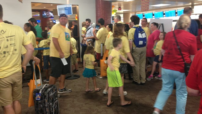 Participants and volunteers of Wings for Autism wait at a gate at Phoenix Sky Harbor International Airport on Aug. 19, 2016.