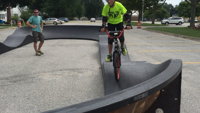 The American Ramp Company set up an all-wheel pumptrack on Wednesday at Lakeside Park. Port Huron resident Lucas Spresser takes his turn around the track.