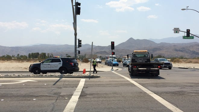 Palm Springs police blocked eastbound Dinah Shore Drive after a car crashed into a tree. A passenger was arrested on suspicion of pushing a firefighter.