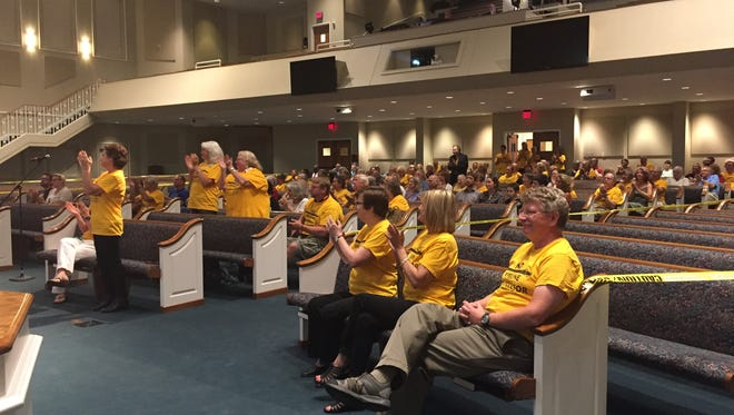 Joelton residents and Concerned Citizens for a Safe Environment applaud a meeting where elected officials spoke out Aug. 25, 2016, against the Kinder Morgan gas compressor project.