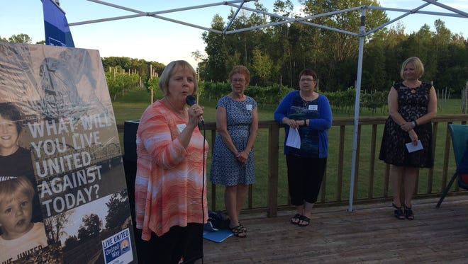 Jeanie Barnard, left, Mary Ellen Smith and Ann Smejkal of the Door County Partnership for Children and Families address the United Way of Door County campaign kickoff event on Wednesday. Amy Kohnle, executive director of the local United Way, looks on.