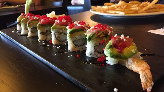 The dragon roll at Smokin Fins, 327 E. Foothills Parkway, features tempura shrimp and cucumber and is topped with avocado, ahi tuna, panko flakes, green onions, habanero masago and eel sauce.