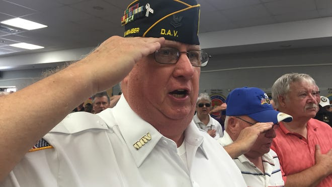 Vietnam War veteran Anthony Aras Jr. of LaGrangeville salutes during the Star-Spangled Banner, as it was played on Tuesday at a Vietnam War commemoration at the VA  Hudson Valley Health Care System at Castle Point..