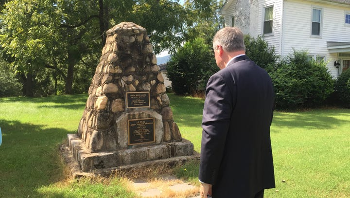 Gubernatorial candidate visits ancestor's grave while campaigning in Greenville County