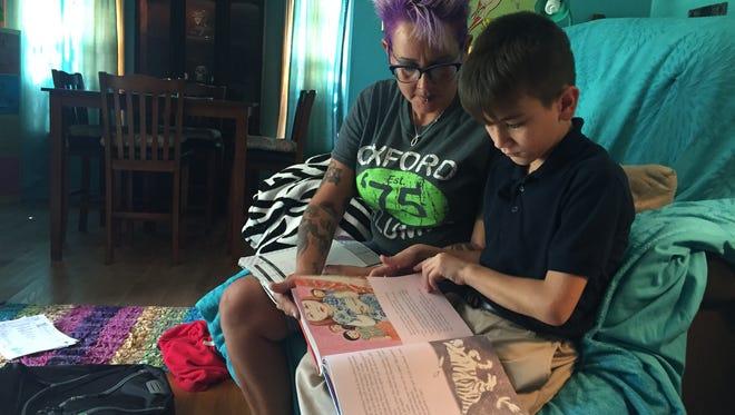 Brandie Bauer reads with her son DJ, 8