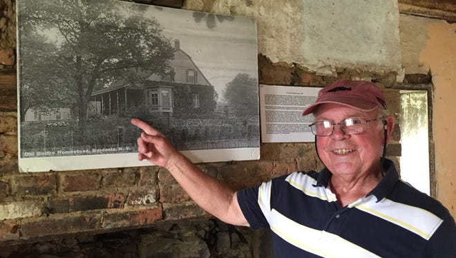 'It needs a lot of work,' says Bob Drennen, a volunteer for Habitat for Humanity, about the Vanderbilt-Budke house. He added, 'It's amazing the house has survived' as he pointed to a 19th century photo of the house.