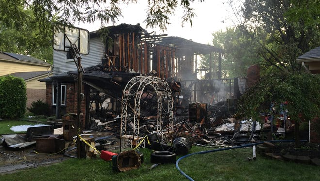 A fire destroyed a two-story home on Merrimac in Canton.