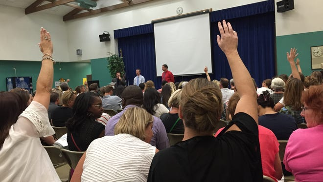 Parents and staff gather at Westergard Elementary School on Wednesday to express their frustration with Washoe County School District over the short notice given for their school's switch to year-round classes.