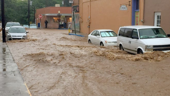 Rain flooded the streets of downtown Silver City early Thursday afternoon. It came in the way of a thunderstorm that lasted a few hours. The forecast called for conitnued showers through Saturday.