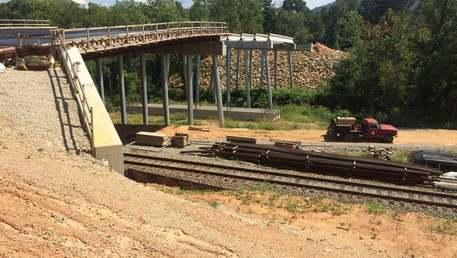 Work has resumed on the Enka Center bridge, which should be finished this fall.