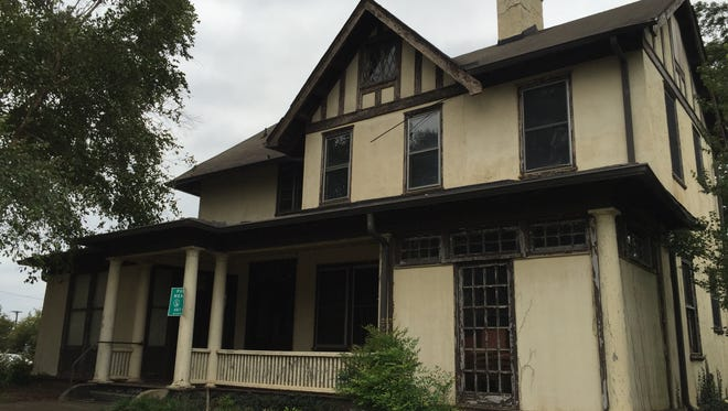 The historic Tudor Revival home that stands in disrepair on Broadus Avenue.