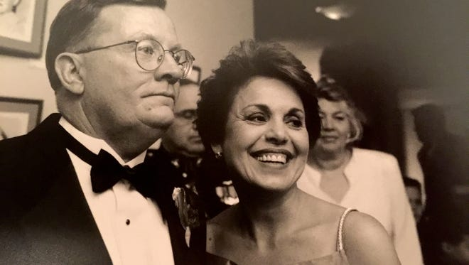 Mercedes Cox and her husband Michael Cox are pictured during their daughter's wedding in Washington, D.C., in 1997.
