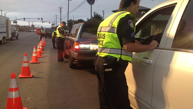 In this file photo, Salinas police conduct a DUI/driver's license checkpoint on Williams Road.