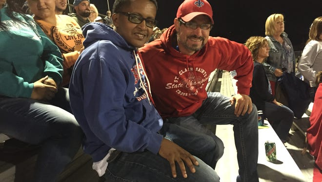 Addis Habtewold and Jon Davidson pose at the St. Clair High School football game Friday night.