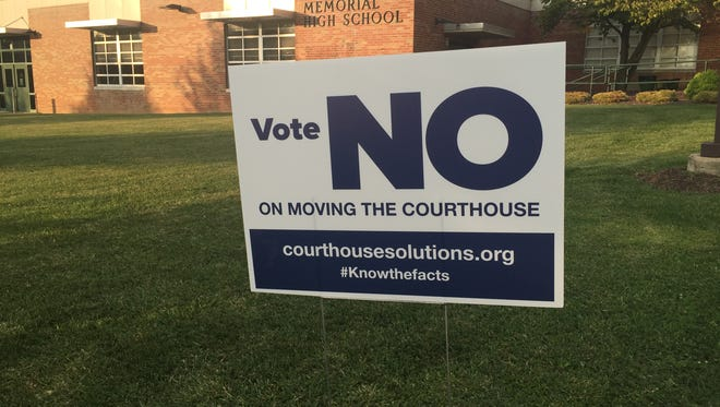 An anti-courthouse sign from Common Sense Courthouse Solutions sits outside the entrance to Wilson Memorial High School in Fishersville, where the first courthouse town hall was held on Wednesday evening.