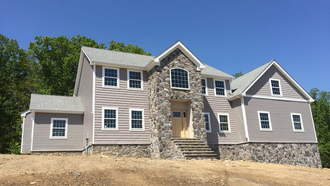 This 3,900-square-foot five-bedroom home at 428 Spotswood Englishtown Road in Monroe   has a full, walk-out basement and four full baths. It will be open to the public from 1 to 4 p.m. today.