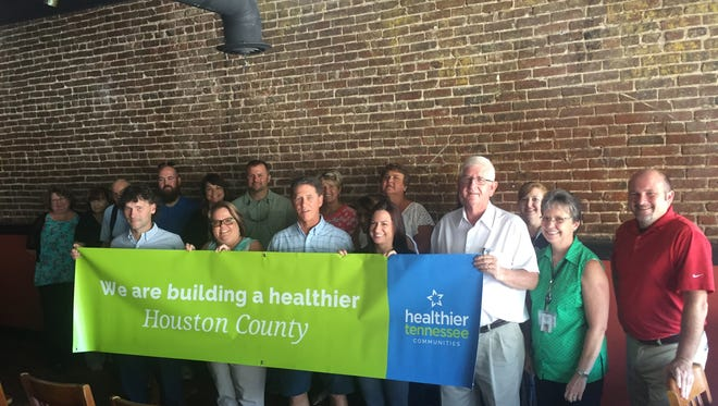 Members of the Houston County Health Council, along with Erin Mayor Paul Bailey, left, and Houston County Mayor George Clark, right, kick off the Healthier Tennessee Communities initiative.