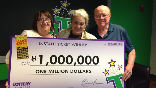 Tennessee Lottery President and CEO Rebecca Hargrove, center, presents a $1 million check to Murfreesboro residents Nancy and Bob Long.