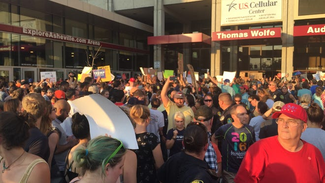 Donald Trump supporters entered the U.S. Cellular Center through a throng of protesters Sept. 12 in downtown Asheville.