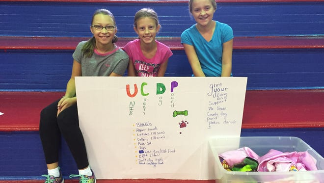 Uniontown Elementary Students Evan Logsdon, Ainsley Elder and Isabelle Duckworth have started a community service project collecting supplies for the Union County Dog Pound.